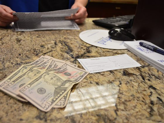 Money on a bank teller counter.