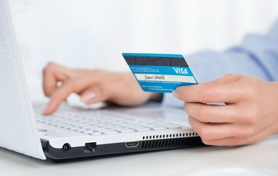 Woman using her credit card to make an online purchase.