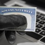 A fraudster with a stolen social security card.