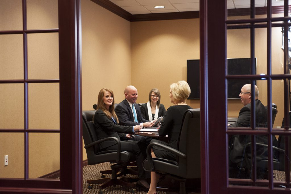 Waterford's Treasury Management Team in a conference room.
