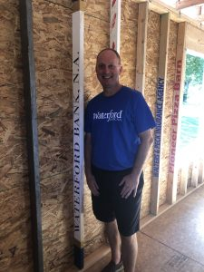 Banker working at a habitat for humanity home build.
