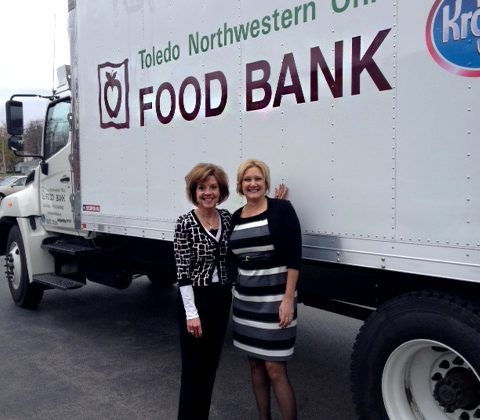 Female bankers collecting food for a food bank.