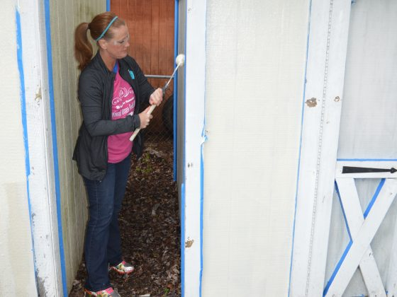 Habitat for Humanity women builders painting a house.