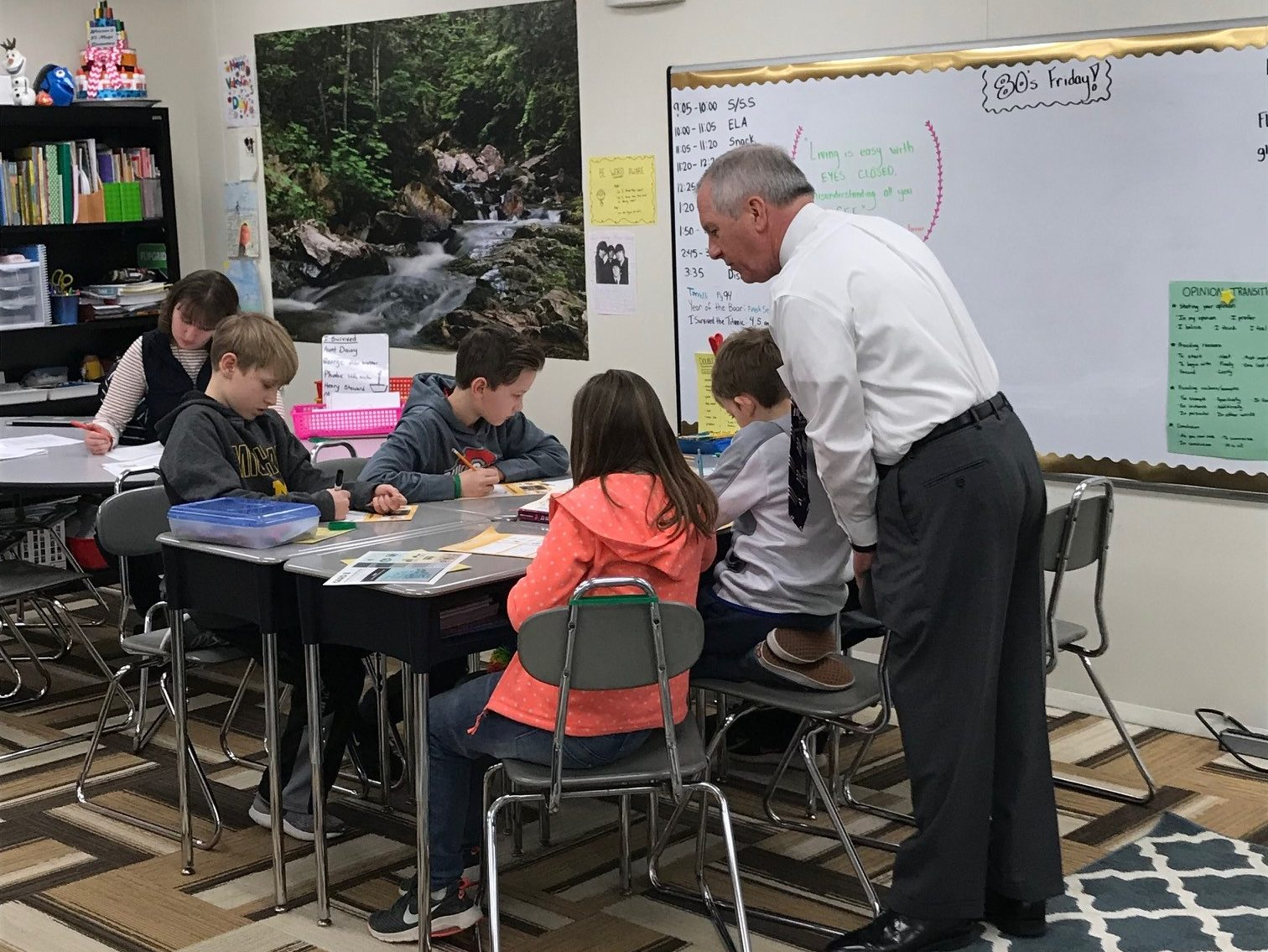 Bankers teaching financial education through junior achievement to local students.