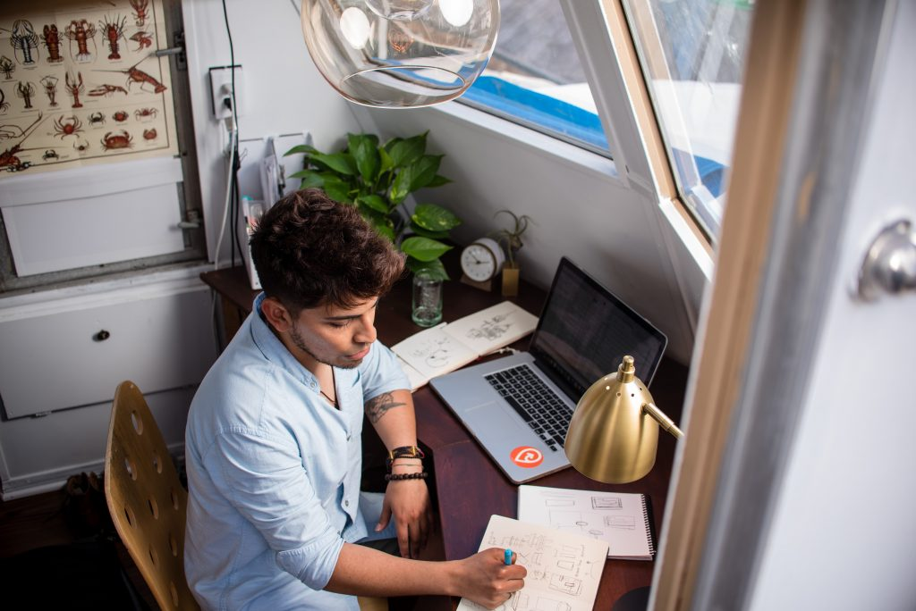 Young entrepreneur using technology to work from home.