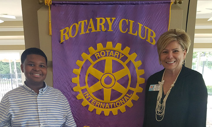 Community outreach - Sylvania Rotary Club Event, Female banker smiling with youth attendee.